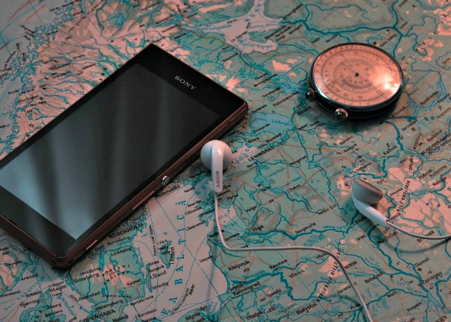 Smartphone with earbuds for audiobooks